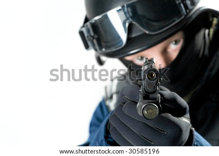the soldier holding the weapon at a shoulder