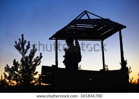 The soldier in the watchtower - stock photo
