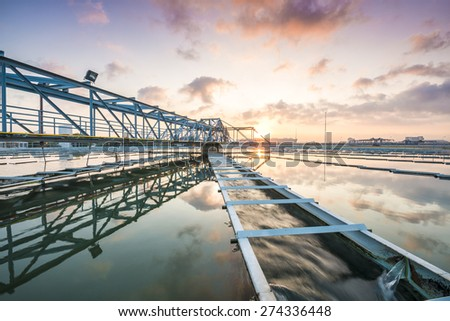 The Solid Contact Clarifier Tank type Sludge Recirculation process in Water Treatment Plant with Sun Rise - stock photo
