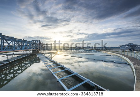 The Solid Contact Clarifier Tank type Sludge Recirculation process in Water Treatment plant with sunrise - stock photo