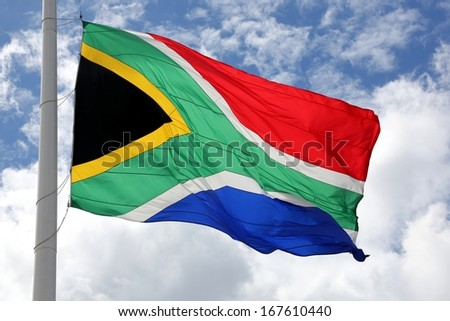 The South African flag fluttering in the breeze - stock photo