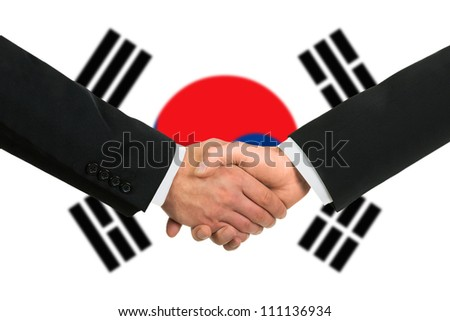 The South Korea flag and business handshake - stock photo