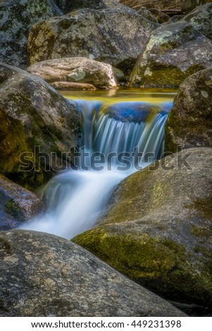 The South Mountains are an isolated, majestic and rugged mountain range near Morganton, North Carolina. These mountains include 10,000 acres and is a great park with many waterfalls along the creek. - stock photo