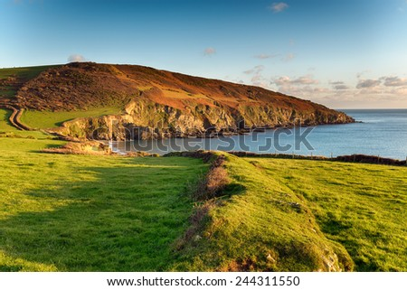 The south west coast path as it passes Hemmick Beach from Gorran Haven - stock photo
