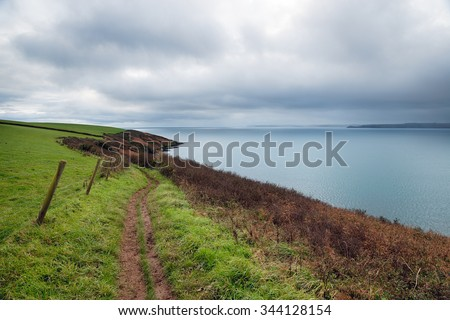 The South West Coast Path near Polkerris on the south coast of Cornwall - stock photo