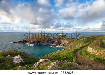 The South West Coast Path on the north Cornwall coast at The Rumps, a rugged promontory jutting out in to the Atlantic ocean and the site of an Iron Age hill fort - stock photo