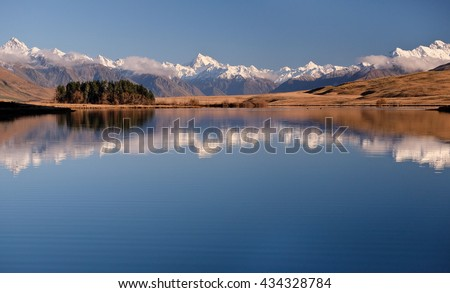 The Southern Alps Reflected in Lake Clearwater.  Hakatere Conservation Park, New Zealand - stock photo