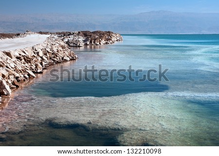 The southern part of the Israeli shore Dead Sea. In the background mountains of Jordan. - stock photo