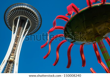 The Space Needle at Seattle Center with glass artworks at the foreground