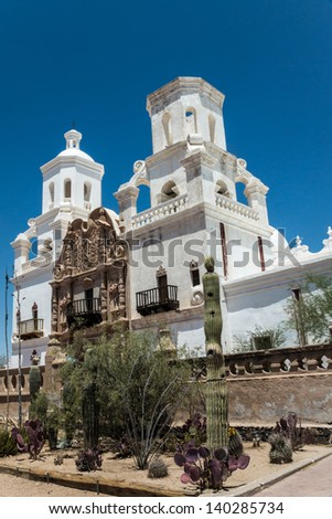 The Spanish colonial Mission San Xavier del Bac has been preserved by the Tohon O'odham tribe and restored to its original grandeur by Italian craftspeople. - stock photo