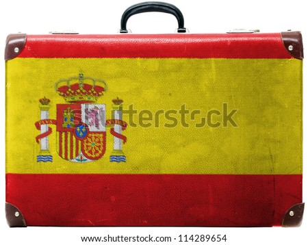 The Spanish flag painted on  old grungy travel suitcase or trunk - stock photo