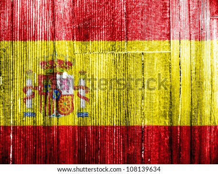 The Spanish flag painted on wooden pad - stock photo