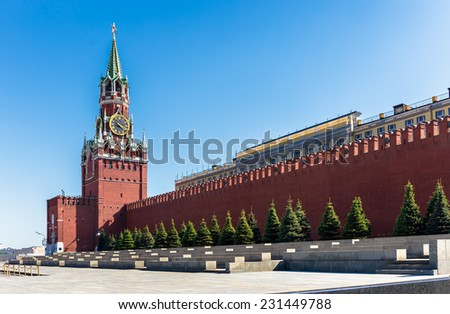 The Spasskaya Tower is the main tower with a through-passage on the eastern wall of the Moscow Kremlin, which overlooks the Red Square.  - stock photo