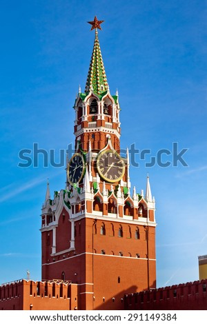 "The Spasskaya Tower translated as ""Savior Tower"" is the main tower with a through-passage on the eastern wall of the Moscow Kremlin situated on Red Square in Moscow, Russia - stock photo"