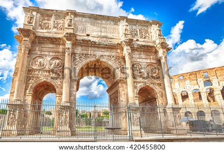 The spectacular Arch of Constantine, located between the coliseum and the Arch of Titus, built to celebrate the triumph of the emperor Constantine in a sunny day. Rome, Lazio, Italy. - stock photo