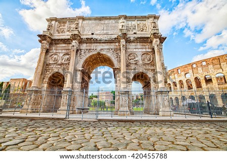 The spectacular Arch of Constantine, located between the coliseum and the Arch of Titus on the Roman road, built to celebrate the triumph of the emperor Constantine. Rome, Lazio, Italy. - stock photo
