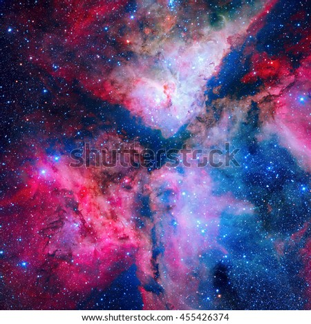 The spectacular star forming Carina Nebula (Grand Nebula). Located in the Carina Sagittarius Arm. Retouched and painted image. Elements of this image furnished by NASA. - stock photo