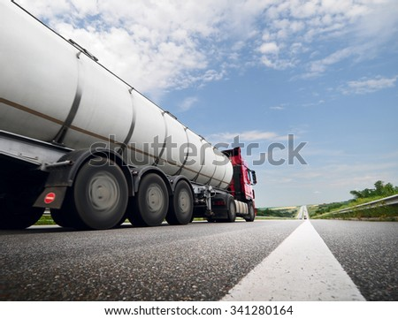 The Speeding Truck on the Highway. Trucking Business Concept - stock photo