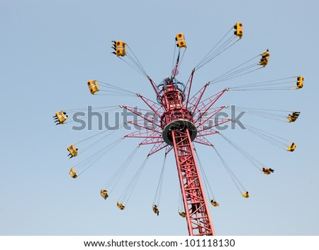 the spinning swing at fairground - stock photo