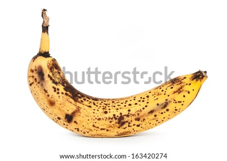 The spoiled banana on a white background - stock photo
