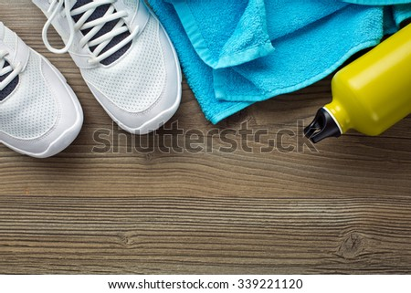 the sport concept. bottle, shoes and towel - stock photo