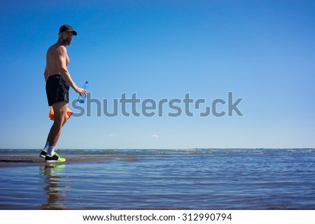 The sportsman on the lake after running drinking water
