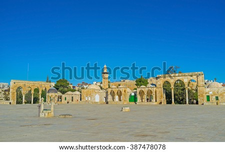 The square, surrounding the Dome of the Rock decorated with the stone colonnades and small buildings, Jerusalem, Israel. - stock photo