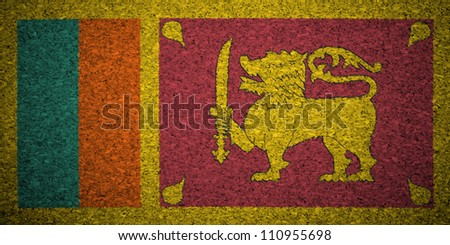 The Sri Lanka flag painted on a cork board. - stock photo