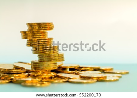 The stacking gold coins for growing business and save money and loan for prepare in the future.