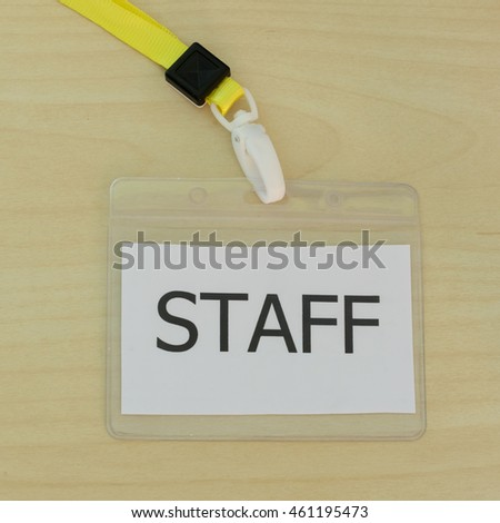 The staff card on wood background.