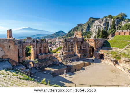 The stage of Taormina's Greek Theater with the Etna in the background, Taormina, Sicily - stock photo