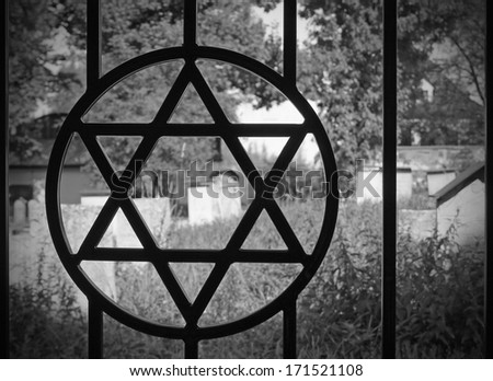 The Star of David overlooking Remuh Cemetery in Kasimierz, the Jewish Old Town of Krakow - stock photo
