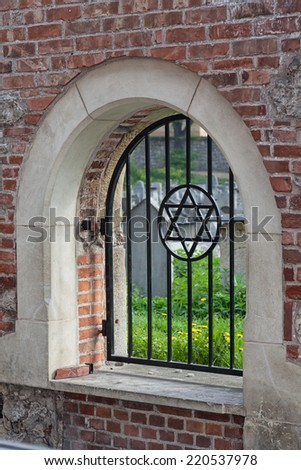 The Star of David overlooking Remuh Cemetery in Kasimierz. The Jewish Old Town of Krakow, Poland. - stock photo