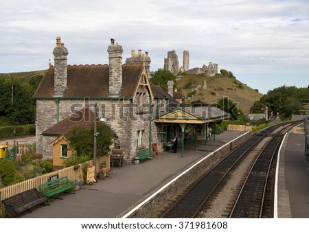 The Station at Corfe Castle. The village of Corfe Castle is named after the ruins of the castle on the hill overlooking the town. The heritage railway has a station here for tourists. - stock photo