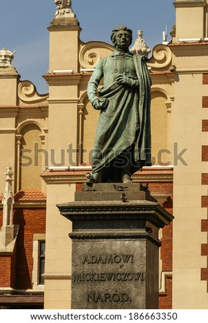 The statue of Adam Mickiewicz in front of the cloth hall in Krakow in Poland - stock photo