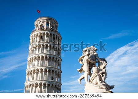 The statue of angels and the leaning tower. Square of Miracles in Pisa, Italy, Europe