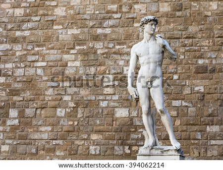 The statue of David by Michelangelo on the Piazza della Signoria in Florence, Italy.  Distracting background items were removed from the wall to provide a cleaner image. - stock photo