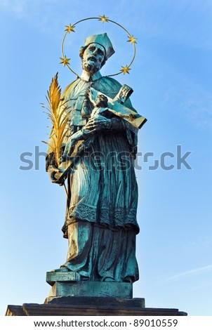 The statue of John of Nepomuk on Charles Bridge (Prague, Czech Republic). Author  Jan Brokoff, 1683. - stock photo