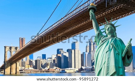 The statue of liberty and Brooklyn Bridge with New York City Manhattan skyline - stock photo
