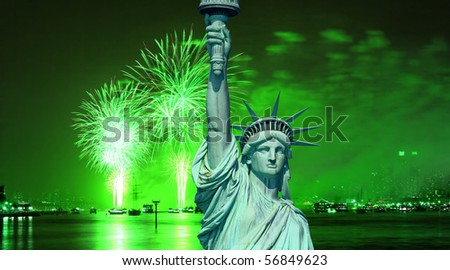 The Statue of Liberty and July 4th fireworks over Hudson River - stock photo