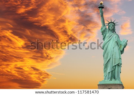 The Statue of Liberty at Sunset, New York City - stock photo