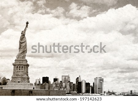 The Statue of Liberty in front of the New York City skyline.