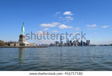 The Statue of Liberty (Liberty Enlightening the World)and the southern tip of Manhattan Island - stock photo