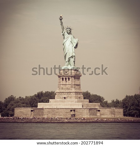 The Statue of Liberty on Ellis Island with retro effect. - stock photo