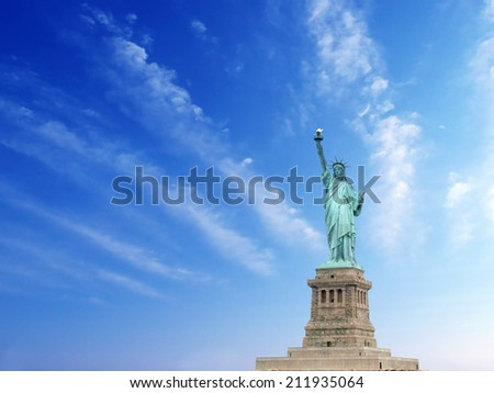 The statue of liberty on the clouds sky background. - stock photo