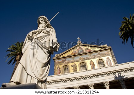 The Statue of the Apostle Paul standing in front of the Papal Basilica of Saint Paul Outside the Walls, Rome, Italy - stock photo