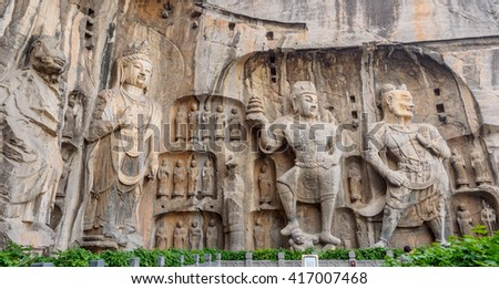 The statue of the Buddhism mythical creatures carved on the mountain rocks in Longmen Grottoes, Louyang, China - stock photo
