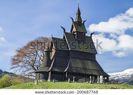 The Stave Church Hopperstad situated on a hill near the magnificent Sognefjord - stock photo