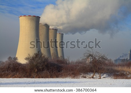 The steam from the cooling towers of power plant. - stock photo