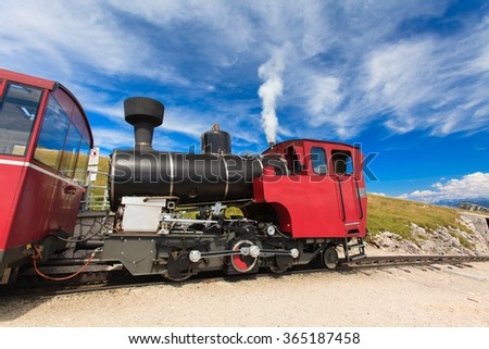 The steam train takes tourists on a mountain peak in the Austrian Alps (Salzburg, Schafberg).